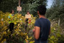 - Western activist try to check the translation of the signs giving information after the closure of the Hungarian-Serbian border on 16 September 2015